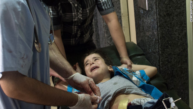 A wounded boy cries during treatment at a hospital after being shot by a sniper in Aleppo, Syria, on Friday, September 21.