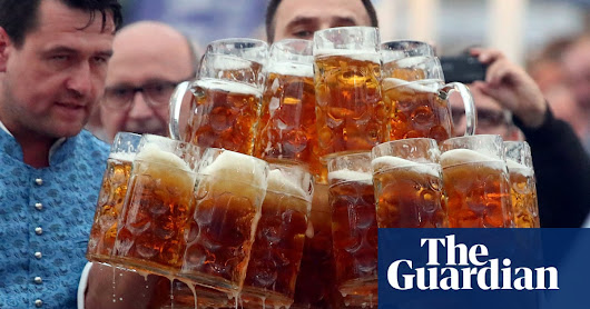 Beer duty: German tax inspector breaks tankard-carrying world record | World news | The Guardian