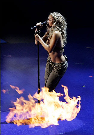 I would have to hide behind something too if I shared the stage with Shakira