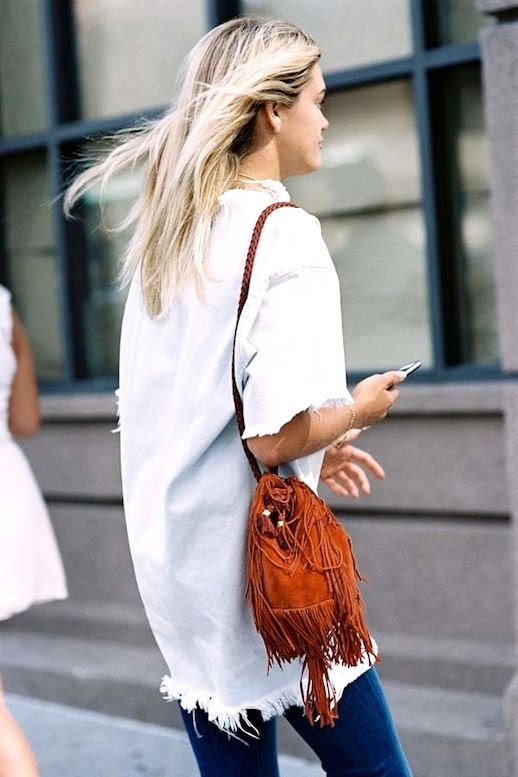 Le Fashion Blog Street Style White Frayed Hem Top Brown Fringe Suede Bag Medium Wash Blue Jeans Via Vanessa Jackman