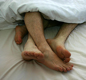 Gay Couple togetherness in bed 01