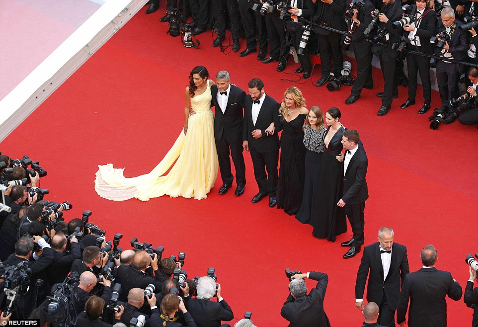 What a gang: Director Jodie Foster (3rdR) and cast members (L-R) George Clooney and his wife Amal, Dominic West, Julia Roberts, Caitriona Balfe and Jack O'Connell all cut stylish figures on the night