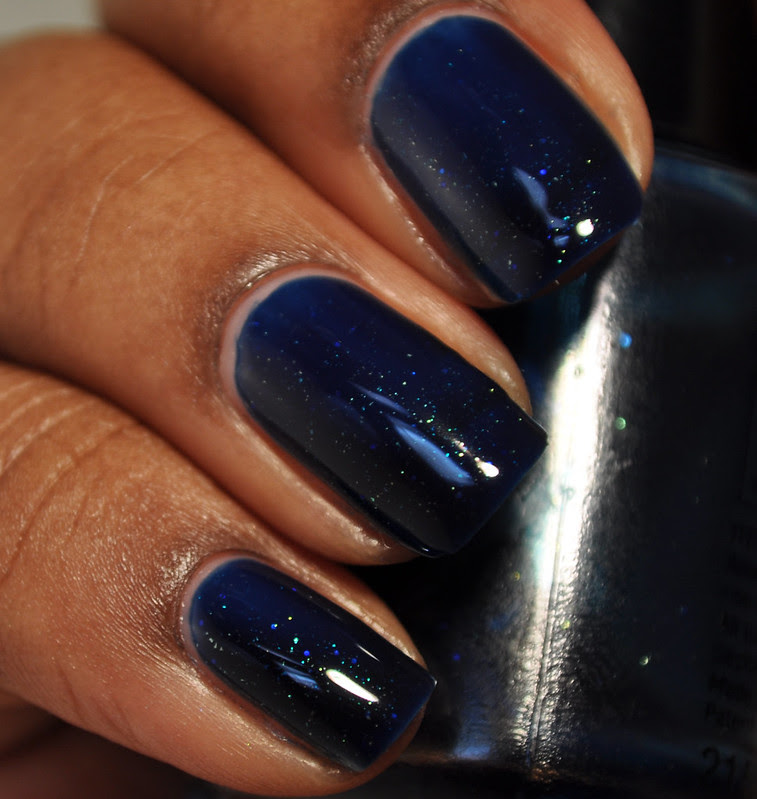 dark blue multicolored shimmer nail polish