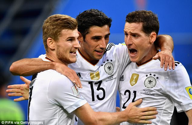 Lars Stindl of Germany celebrates scoring his side's first goal with team-mate Timo Werner