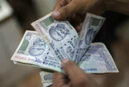 RBI's intervention helps rupee post biggest single-day rise in 15 years - The Times of India