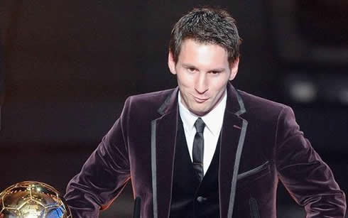 Lionel Messi looking funny and dressed as a clown, in a purple smoking at FIFA Balon d'Or 2011-2012 ceremony
