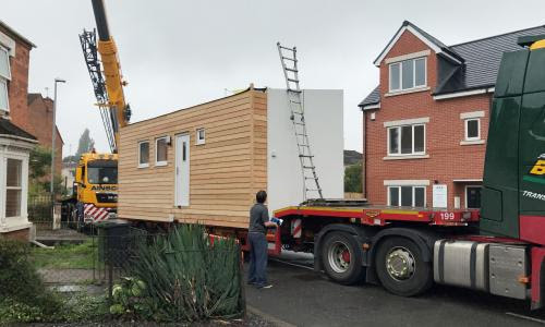 First 'micro home' lands in Worcester charity's back garden | Society | The Guardian