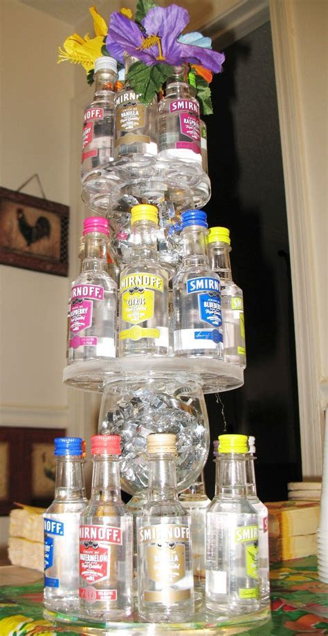 Vodka mini bottle tower centerpiece for a Luau themed