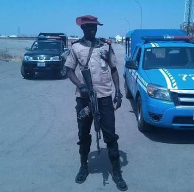 Road Safety Officer Carrying Guns? (see Photo