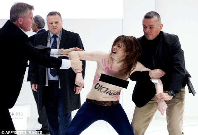 Anger: Several activists stormed the booth of Volkswagen to demonstrate in presence of Merkel and Putin