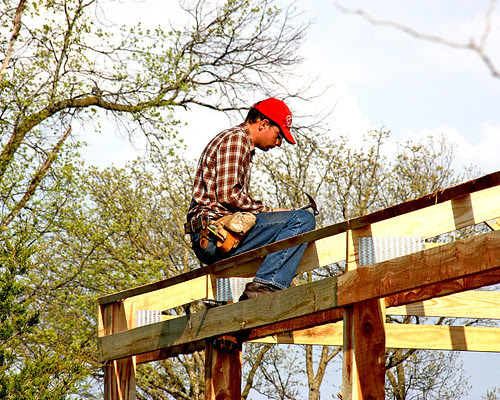 Praise God for this wonderful friend! - Galen's friend, Kirk, hard at work on the roof of the new shed.  He has been  a LOT of help to Galen on this shed.