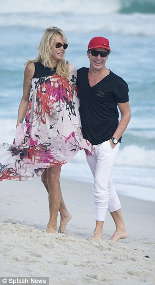 Klein and Foster, both 49, laughed as they chatted and walked down the Miami beach on Monday