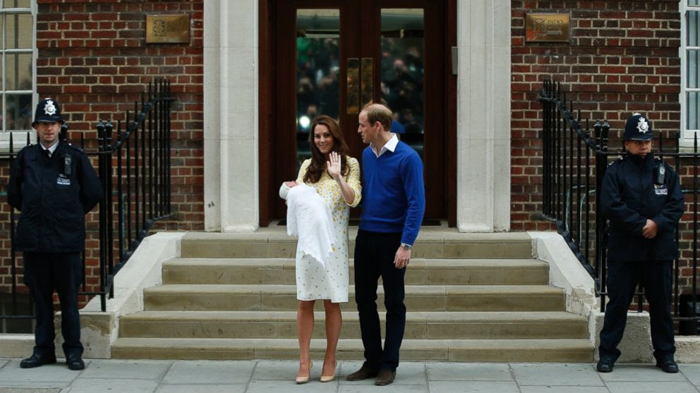 PHOTO: Britains Prince William, center right, and Kate, Duchess of Cambridge, center left, pose for the media with their newborn daughter outside St. Marys Hospitals exclusive Lindo Wing, London, Saturday, May 2, 2015.