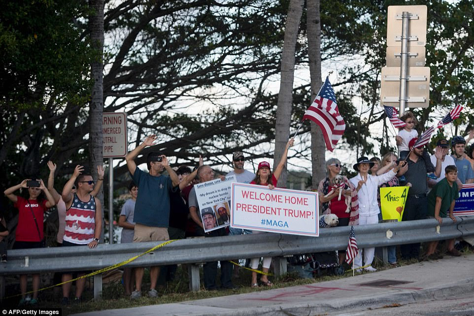 Supporters line the street as the motorcase of US President Donald Trump drives to Mar-A-Lago in Palm Beach on Thursday