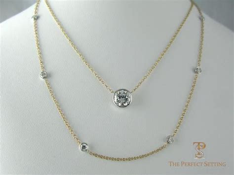 Resetting   Unworn Diamond and Sapphire Ring to Necklace