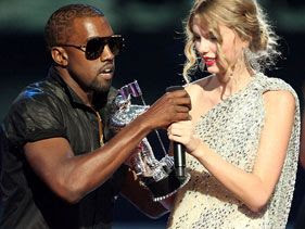 Rapper Kanye West grabs the mic from Taylor Swift after storming the stage at the 2009 MTV VMAs.