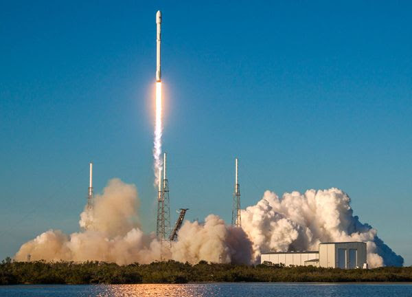 A SpaceX Falcon 9 rocket carrying NASA's Transiting Exoplanet Survey Satellite (TESS) launches from Cape Canaveral Air Force Station in Florida...on April 18, 2018.