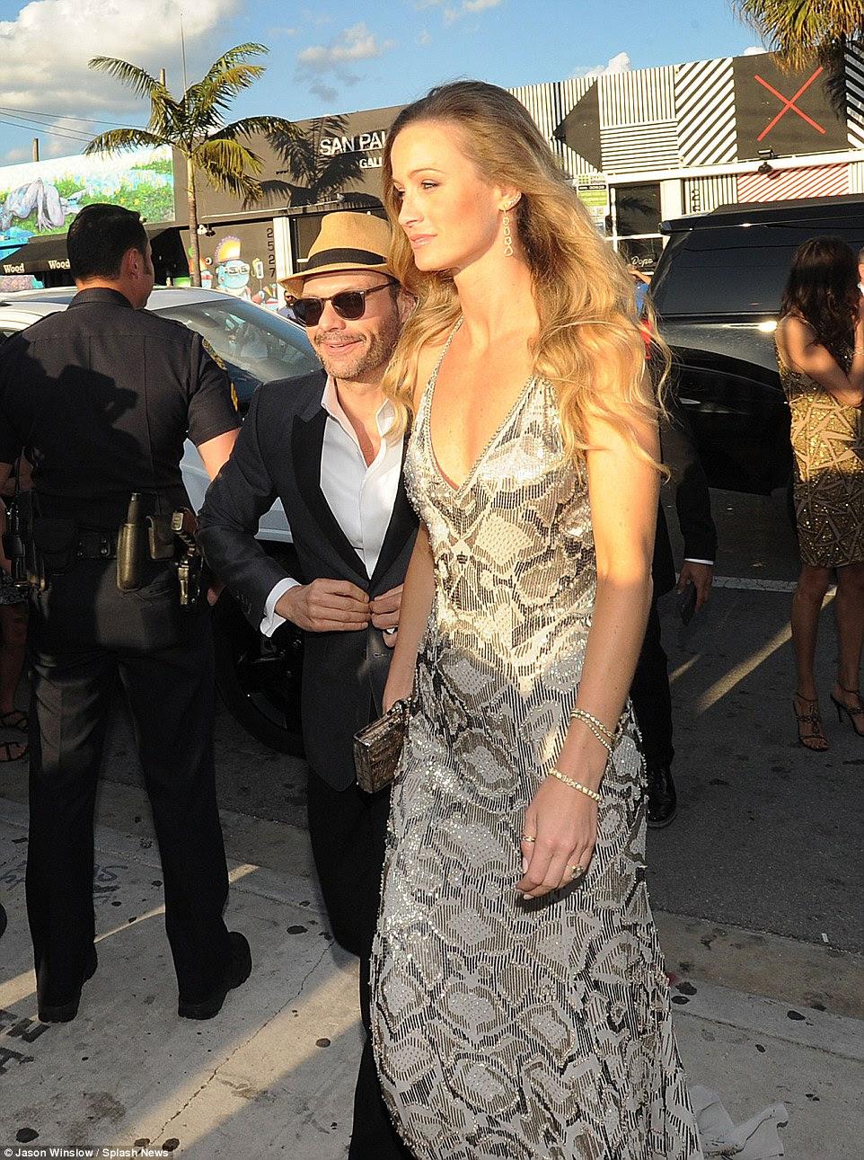 American Idol presenter Ryan's girlfriend Hilary towered over the diminutive presenter