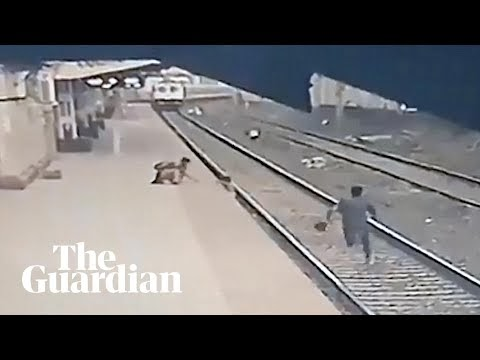 Railway worker saves boy from being run over by train