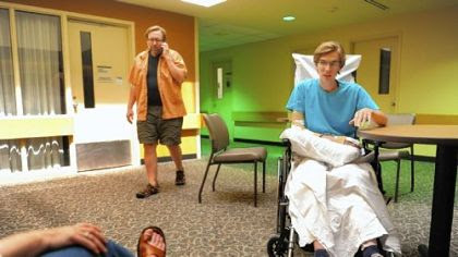 Dan Yablonsky, 23, speaks with the Post-Gazette from HealthSouth Harmarville Rehabilitation Hospital Monday as his mother, Fran, left, listens and his father, Bud, center, takes a phone.