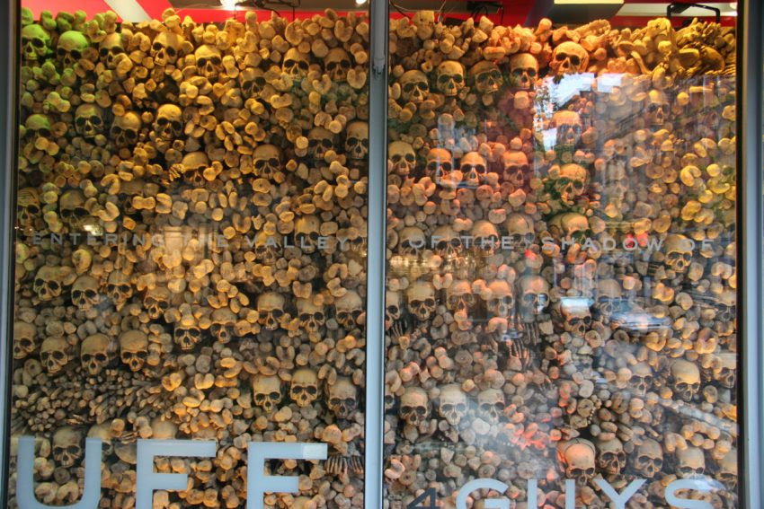 25 Examples of Halloween Retail Displays to Inspire You - Skull Window Display - Halloween Retail Displays - Halloween Retail Ideas - Halloween Display Ideas