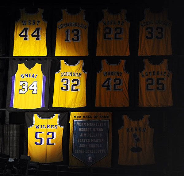 Despite the fact his last name and number was apparently printed on the wrong side, Shaq's jersey hangs next to those of other Laker legends on the rafters at STAPLES Center, on April 2, 2013.