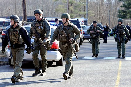 State Police are on scene following a shooting at the Sandy Hook Elementary School in Newtown, Conn., about 60 miles (96 kilometers) northeast of New York City, Friday, Dec. 14, 2012.