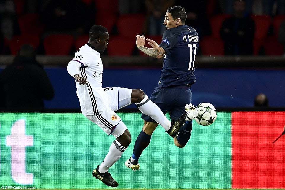 Ivorian defender Adama Traore manages to retrieve the ball for the away side from the control of PSG's di Maria