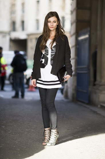 A sporty tee tempered the sexier side of her look, a pair of animal-print lace-up heels.  Source: Adam Katz Sinding