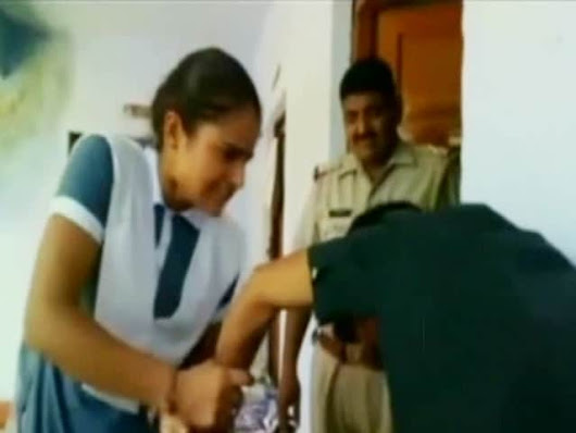 Inside Police Station, Schoolgirl Thrashes Boy Who Harassed Her