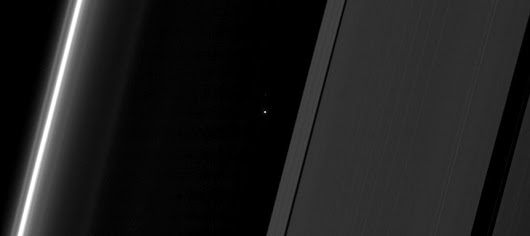 Earth Beams From Between Saturn's Rings in New Cassini Image - Universe Today
