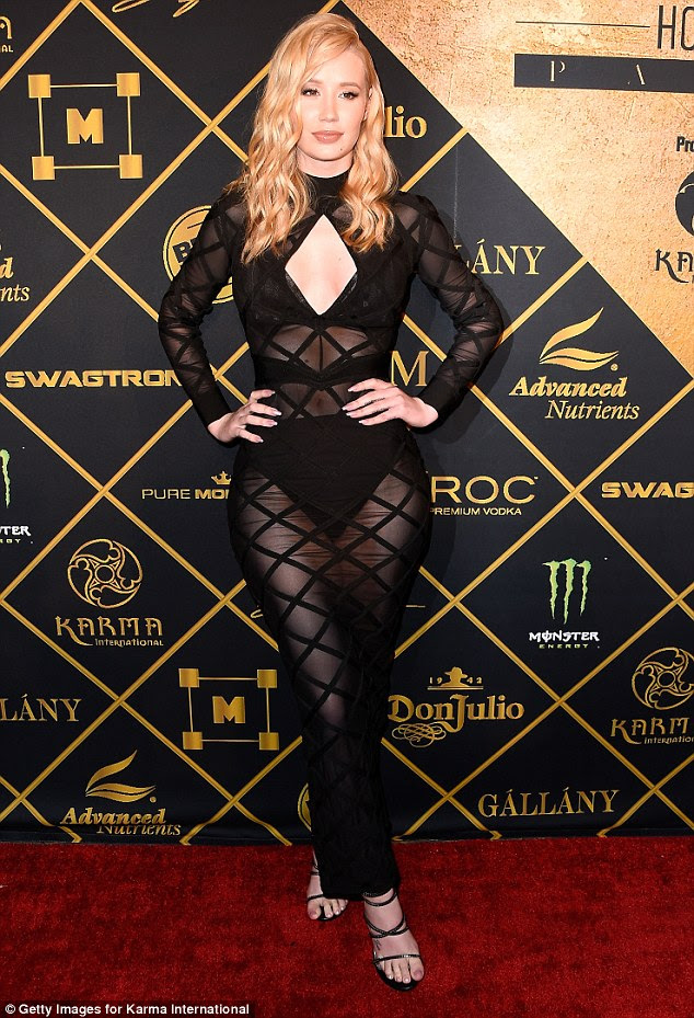 Flaunting her figure:  Featuring a key-hole design, Iggy flashed more than a hint of cleavage as well as her black lacy bra - thanks to the cutaway detailing and the the see-through nature of her dress