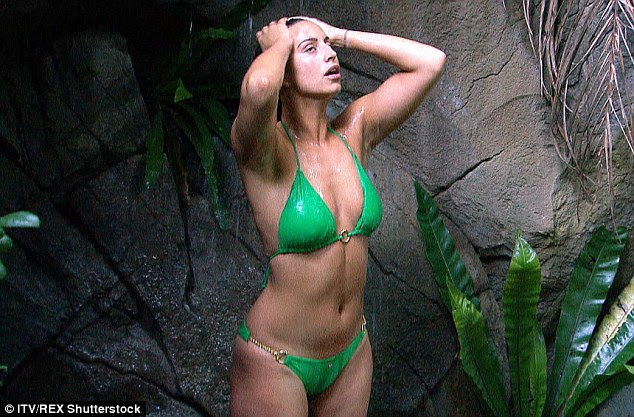 Gorgeous in green: Ferne was no doubt making her fellow campers green with envy as she enjoyed a wash in a stunning emerald-coloured bikini white flaunting her curves