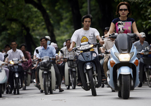 Uber Loan Program Helps Vietnamese Swap Scooters for New Hondas