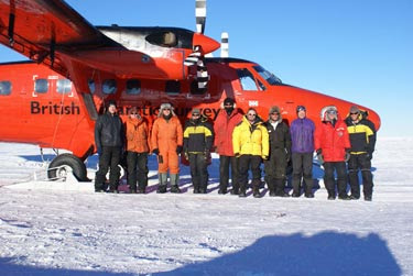 Some of the AGAP team pose with a Twin Otter