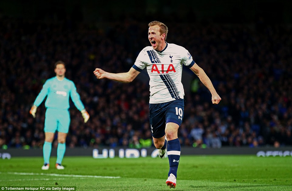 Kane races away to celebrate after his 35th-minute strike blows the Premier League title race open once more