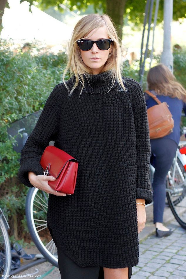 Le Fashion Blog -- Copenhagen Street Style: Emma Elwin Ray Ban Wayfarers Oversized Turtleneck Sweater Red Clutch -- Via Malmo Street Style -- photo Le-Fashion-Blog-Copenhagen-Street-Style-Emma-Elwin-Ray-Ban-Wayfarers-Oversized-Turtleneck-Sweater-Red-Clutch-Via-Malmo-Street-Style.jpg