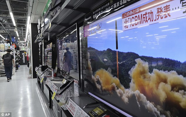 A local TV news shows what was said to be the launch of a Hwasong-14 intercontinental ballistic missile, ICBM, aired by North Korea's KRT, at a consumer-electronics retailer in Tokyo