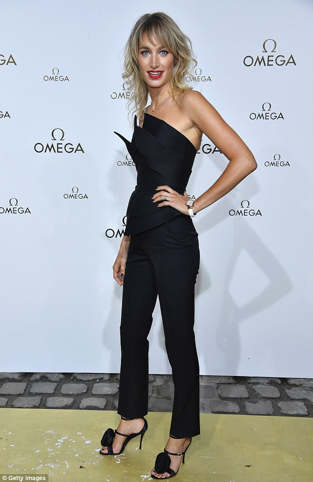 Legs eleven: Actress Pauline Lefèvre was looking sensational in a structured black jumpsuit with chic matching heels while her hair was coiffed to perfection