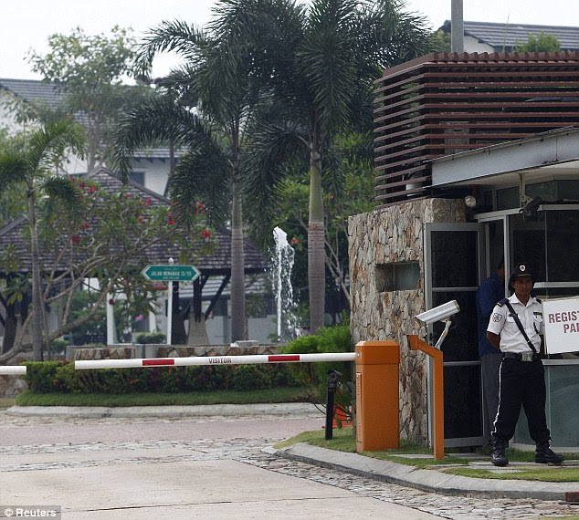 Officers are said to have spent two hours searching the pilot's home today inside the luxury compound