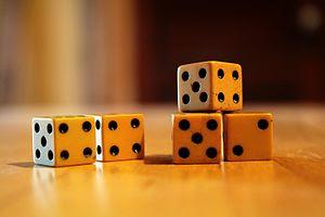 English: Five ivory dice.