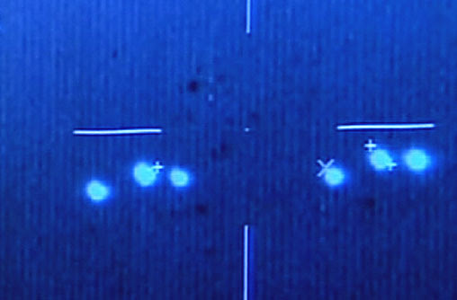 1. Image made from a video shows unidentified flying objects in the skies over southern Campeche state filmed by Mexican Air Force pilots, in 2004. The tape shows the bright objects, some sharp points of light and others like large headlights, moving rapidly in what appears to be a late-evening sky.