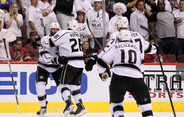 The Los Angeles Kings celebrate after defeating the Phoenix Coyotes and winning the NHL Western Conference championship, on May 22, 2012.