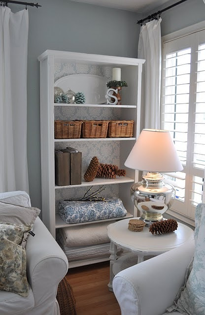 DIY wallpapered bookcase. For shelves in dining room.