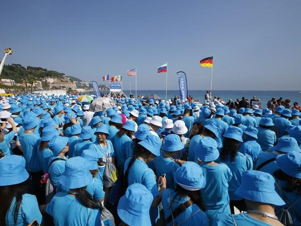 O empresário chinês Li Jinyuan pagou quatro dias de férias na França para os seus funcionários (Foto: AFP Photo/Valery Hache)