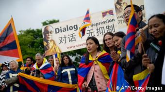 GettyImages 169510481 Free Tibet protestors demonstrate as the German Chancellor and China's new prime minister meet at the Chancellery in Berlin on May 26, 2013. Chinese Prime Minister Li Keqiang is on his first political tour as the new Chinese premier. Germany is his country's largest trading partner in the European Union. The two major exporters seek to further strengthen economic ties amidst ongoing trade conflicts between Beijing and the EU. AFP PHOTO / ODD ANDERSEN (Photo credit should read ODD ANDERSEN/AFP/Getty Images)