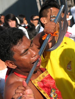 No pain, no gain. Vegetarian Festival in Phuket