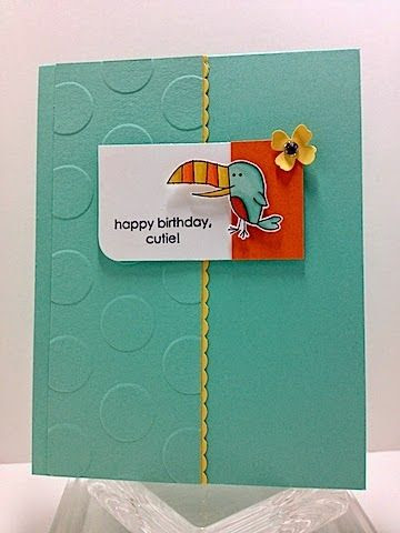 Toucan Cutie. I like the design of this—embossing on one side, the little edgelit peeking out, the rounded corner.