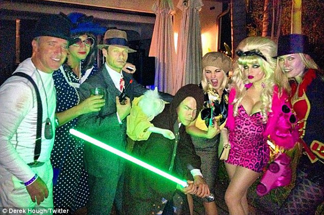 Party people: Fergie joined a star-studded Halloween bash on Friday which included Derek and Julianne Hough, Ryan Seacrest, and Rosie Huntington-Whiteley: Inside the party, the 27-year-old put his hood up and switched his laser sword on