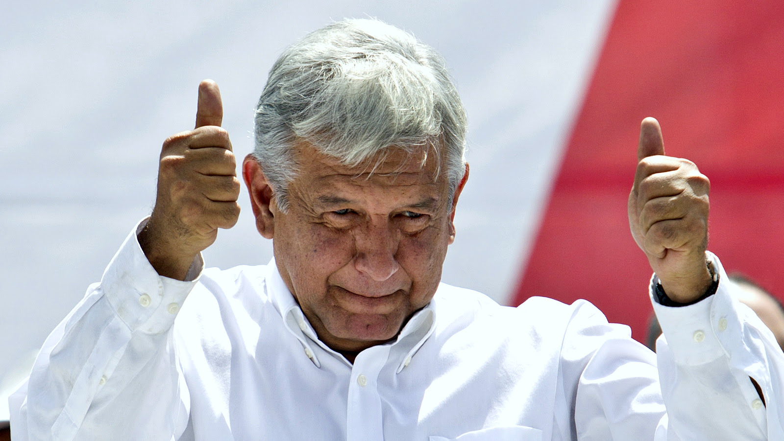 Andres Manuel Lopez Obrador, Mexican presidential candidate , gives a thumbs up to his supporters at Mexico City's main plaza, the Zocalo, Sunday, Sept. 9, 2012. (AP/Christian Palma)